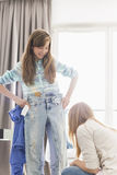 Sisters trying on clothes at home Royalty Free Stock Photography