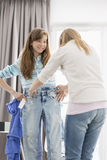 Sisters trying on clothes at home Royalty Free Stock Images