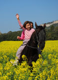 Sisters twins and horse Royalty Free Stock Image