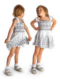 Sisters twins in white dresses play Royalty Free Stock Photos