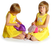Sisters twins in yellow dresses Royalty Free Stock Images
