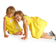 Sisters twins in yellow dresses Stock Image