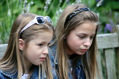Sisters. Two blonde girl seen from the side stock photos