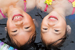Sisters at a wading pool. Two sisters enjoying a rest in a wading pool stock photo