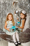 Sisters waiting for Christmas. Stock Image