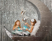 Sisters waiting Christmas. Royalty Free Stock Photo