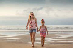Sisters walking on the beach Stock Image
