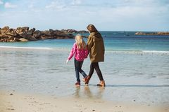 The sisters walking on the shore of the sea. At  the Tregastel, Brittany. France stock photos
