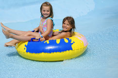 Sisters water fun. Wild river water attraction for sisters Stock Image