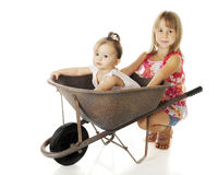 Sisters with a Wheelbarrow Royalty Free Stock Photo