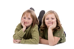 Sisters on white background Stock Photos