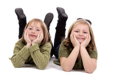 Sisters on white background Stock Images