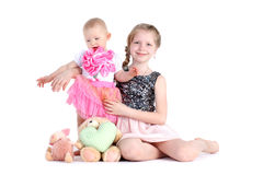Sisters 8 year and  11 month old on white Stock Images