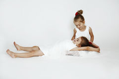 Sisters. Young sisters on the white floor Stock Photography