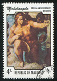 Sistine Chapel. MALDIVE ISLANDS CIRCA 1975: stamp printed by Malldive Islands, shows Paintings from Sistine Chapel, Michelangelo, circa 1975 Royalty Free Stock Images