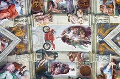 Sistine kapell med guden som pekar till en Ducati 916 motorcykel Arkivfoto