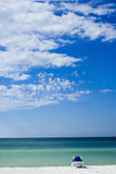 Sit back & relax. Picture of a chair on a beach facing the sea signifying relaxation Stock Photo