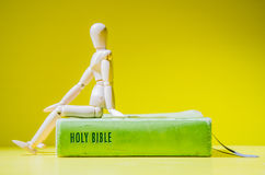 Sit on the Bible(focus at text) Royalty Free Stock Photo