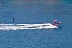 Sit down hydrofoil ski sport. Speedboat on blue sea Royalty Free Stock Photo