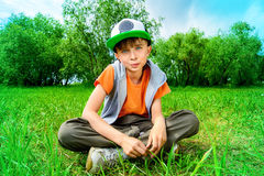 Sit on grass Stock Image