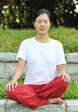 Sit in meditation. Asian woman sit in meditation outdoor Royalty Free Stock Images