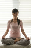 Sit in meditation Stock Image