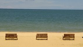 Sit Sit Sit. Three chairs on the beach to waiting for someone Royalty Free Stock Photography