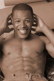 Sit ups. Young african american male doing sit ups Royalty Free Stock Photo