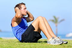 Sit-ups - fitness man training sit up outside Royalty Free Stock Photography