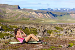 Sit-ups fitness woman doing pushups outside Royalty Free Stock Image