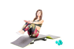 Sit-ups on mat Royalty Free Stock Images