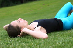 Sit-Ups Workout. Girl doing sit-ups exercises outdoor Royalty Free Stock Photo