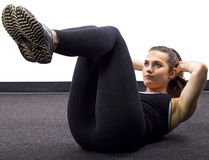Sit Ups. Young Caucasian woman doing situps/crunches Royalty Free Stock Photo