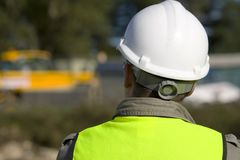 On Site. A construction worker on site and dressed in safety clothing Royalty Free Stock Image