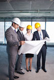 On site. Businessmen look at a building site plan Stock Photo