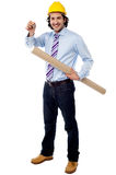 Site engineer holding building plan and a key. Civil engineer holding construction plan and a key Royalty Free Stock Images
