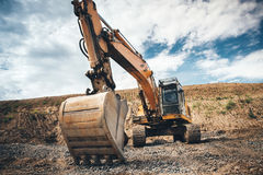 Site excavator. details of roadworks with heavy duty machinery. Highway construction site excavator. details of roadworks with heavy duty machinery Royalty Free Stock Photo