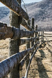 Site fencing made of wooden boards and barbed wire Royalty Free Stock Photo