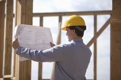 Site Manager Analyzing Building Plans Stock Photography