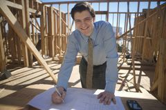 Site Manager With Building Plans Royalty Free Stock Images