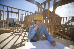 Site Manager With Building Plans Royalty Free Stock Photo
