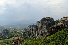 Meteora, monasteries on rocks in Greece holy. Site of Meteora, Greece, where ancient and working Monasteries are built throughout and on top of unusual Royalty Free Stock Images