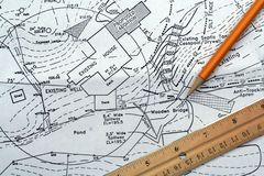Site Plan. This is a close up of a residential site plan with a pencil and ruler stock photography