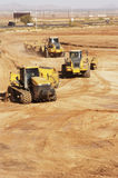 Site preparation 5. Earthmoving equipment at work preparing a construction site for development Royalty Free Stock Photo