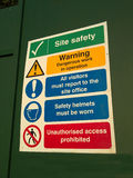 Site Safety sign. Building site safety notices on hoarding Stock Photo