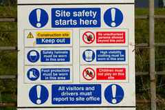Site safety sign. A white board with symbols and warnings explaining site safety rules and precautions Stock Photo