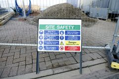 Site safety sign and construction entrance fence. Uk royalty free stock photo