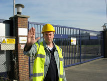 Site security. Access to work site being denied by gate security man Royalty Free Stock Images