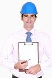 Site surveyor. Holding clip-board royalty free stock photo