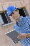 Site surveyor using tablet Stock Photography